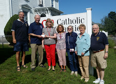 Knights of Columbus Presenting Check to Catholic Charities